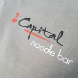 Printed for the popular Capital Noodle bar, a 3-color print with white underbase.