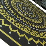 An oversized bandana printed with  gold and silver shimmer ink.